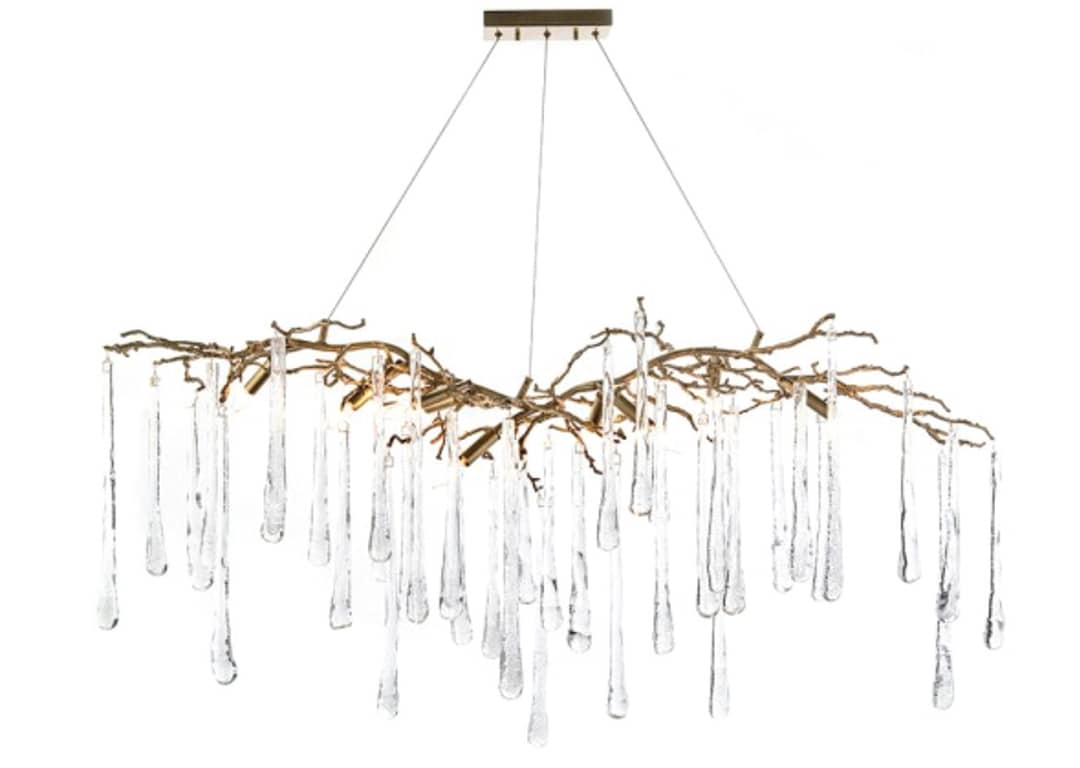 BRASS & GLASS TEARDROP CHANDELIER This nine-light, organically formed chandelier features brass branches and handblown glass teardrops.