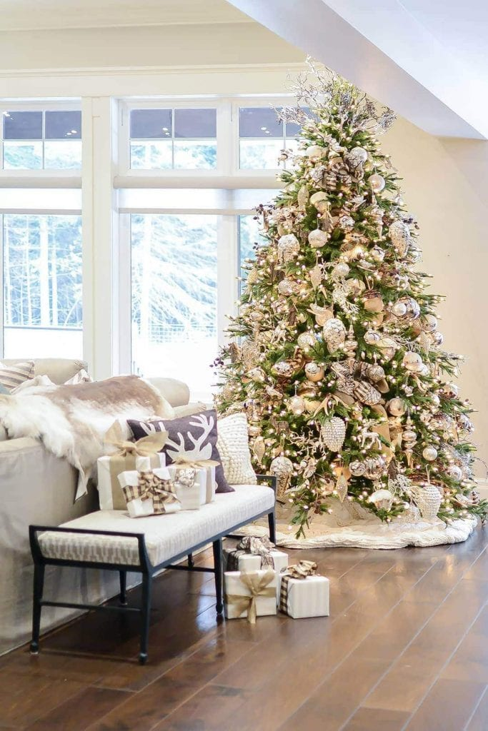 Designer Sandi Loreen Duclos created a stunning tree and well as embellishing every part of the room.