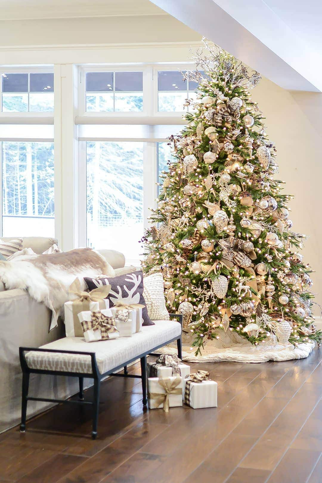 HOME FOR THE HOLIDAYS Designer Sandi Loreen Duclos created a stunning tree and well as embellishing every part of the room.