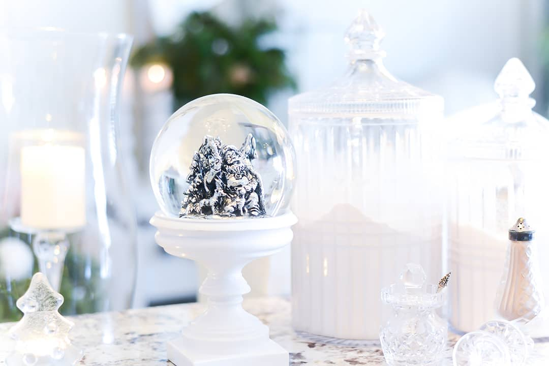 Chrystal is used as decor and also functions has decanters, salt and pepper shakers displayed on countertops, along with a pretty white snow globe and flickering candle.