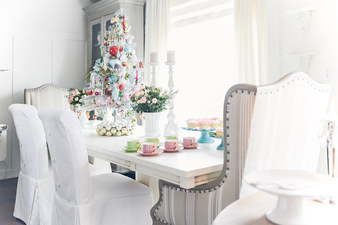 Stunning table top Christmas tree with colourful ornaments, tea cups and cupcakes.